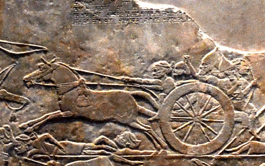 Assyrian_soldiers_rushing_the_head_of_Teumman_to_Nineveh