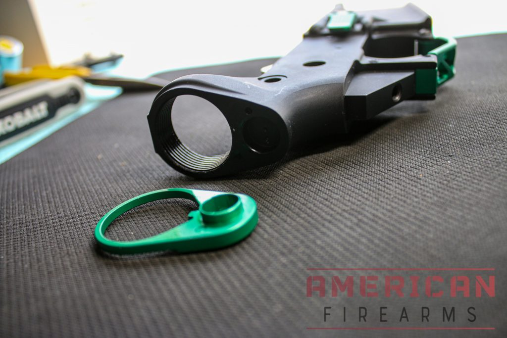 Slide the QD attachment onto the buffer tube with the protruding side facing the lower.